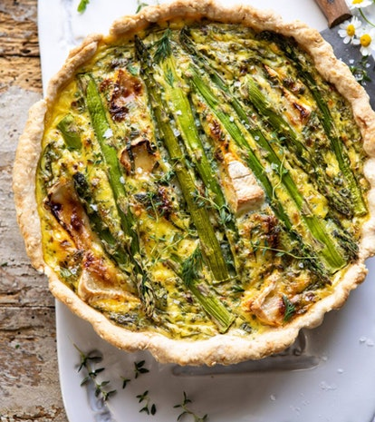 Half Baked Harvest's asparagus and brie quiche recipe is the perfect use for your store-bought pie crust.