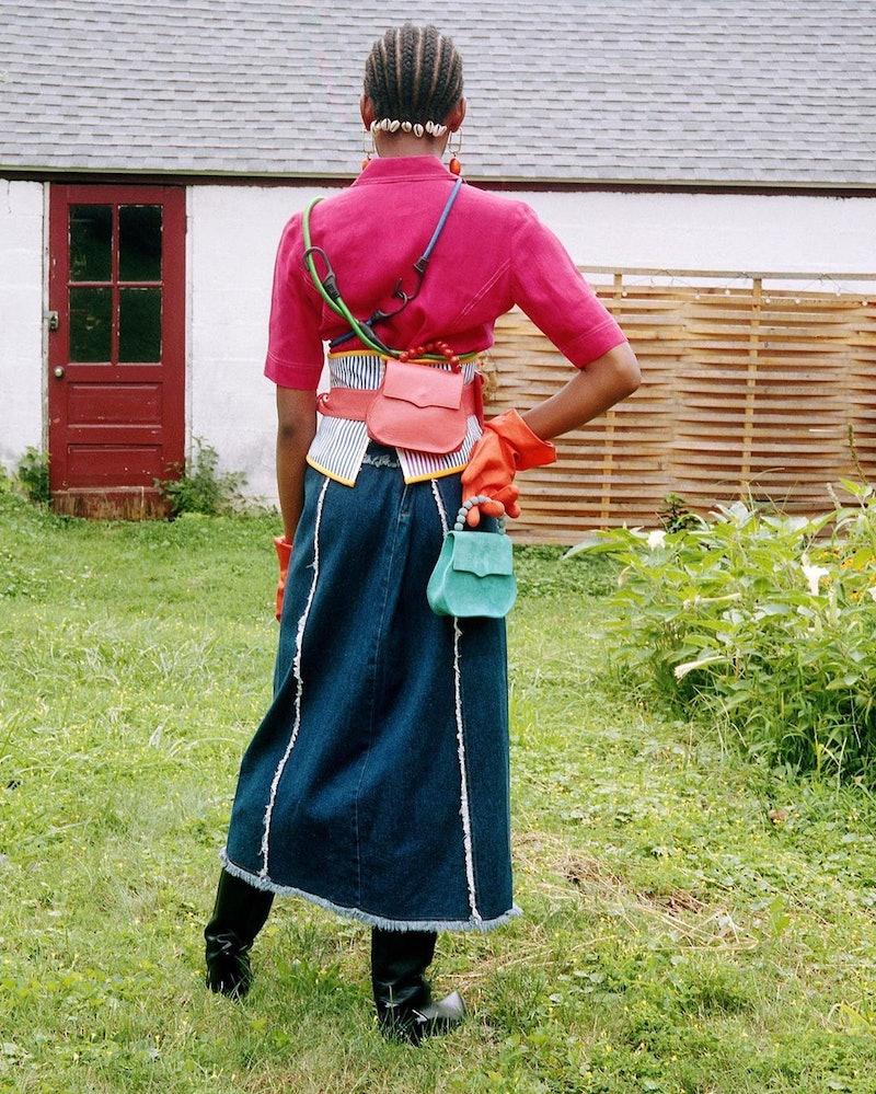 Model wearing EDAS bags.