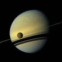 Titan is drifting away from Saturn 100 times faster than predicted