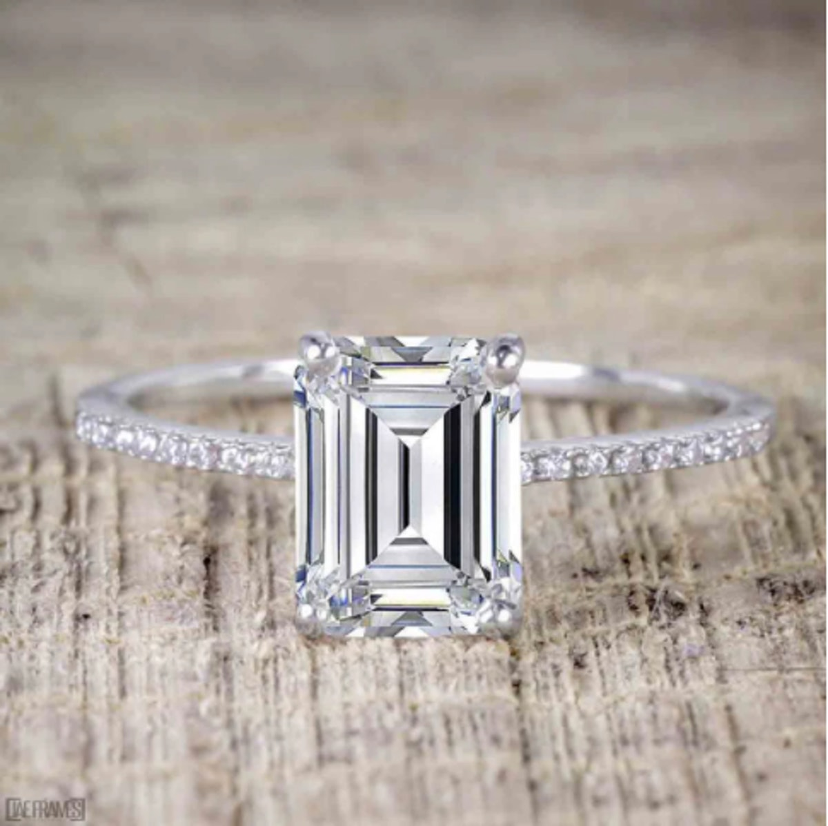 1.25 Carat emerald cut Moissanite and Diamond Solitaire Engagement Ring in 10k White Gold