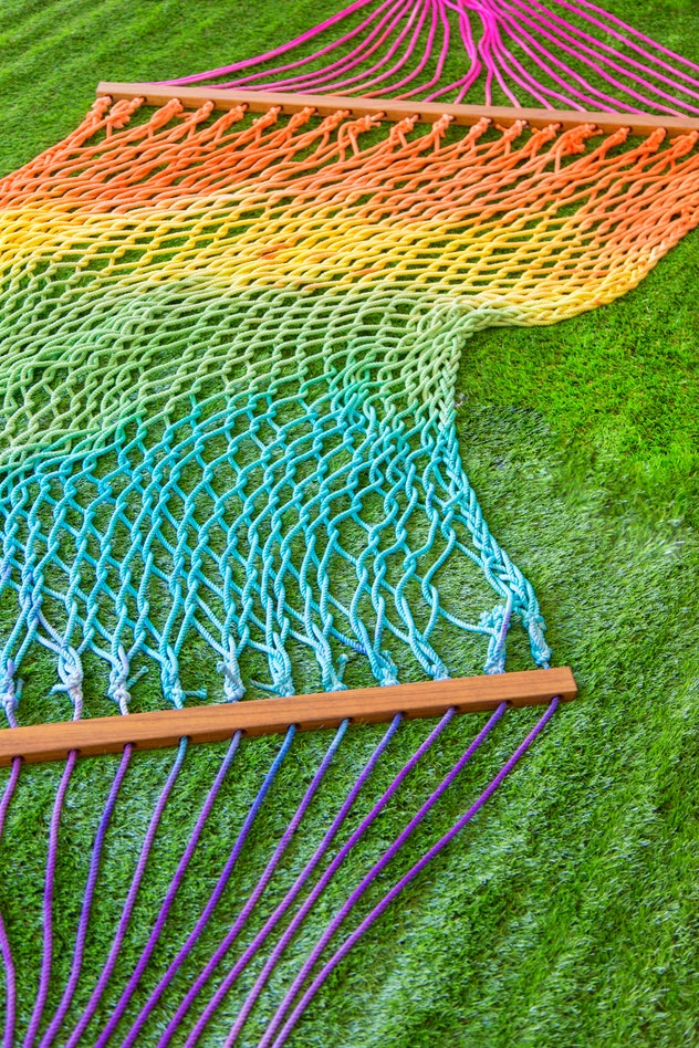 A tie-dye rainbow hammock is the perfect tie-dye craft to do with your kids.