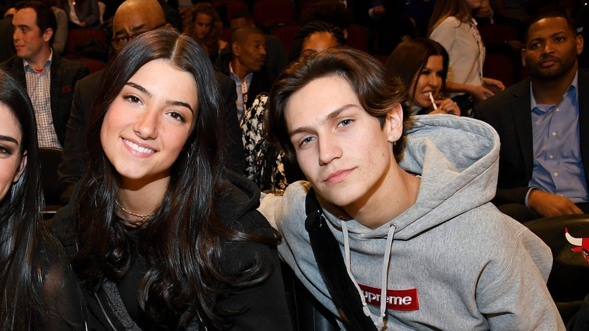 Chase Hudson and Charli D'Amelio attend a basketball game.