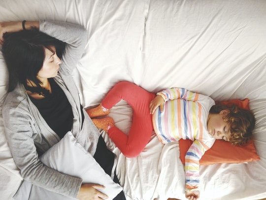 Mother and child on a sofa, snoozing