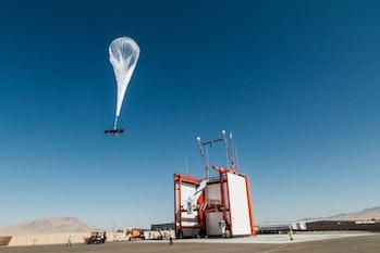 A Loon balloon taking flight.