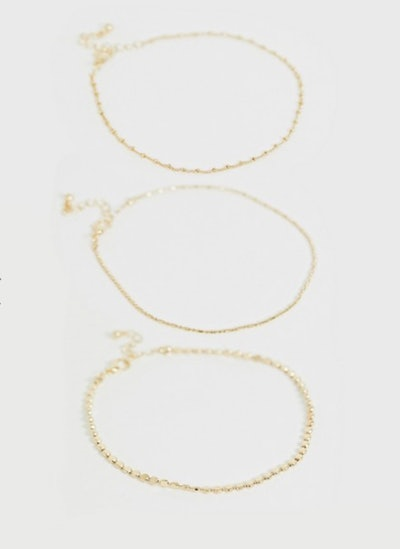 Curve pack of 3 anklets with dot dash and disc in gold tone