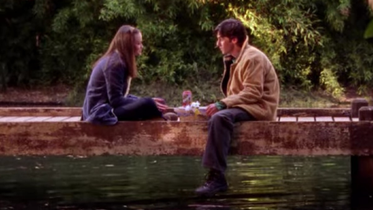Rory and Jess sit down by the lake for a picnic in 'Gilmore Girls.'
