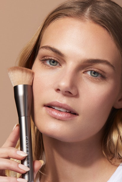 Cover FX's newest brush features three wells for placing product.