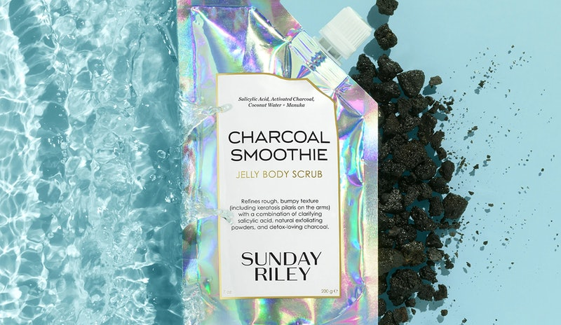 Sunday Riley's new Charcoal Smoothie Jelly Body Scrub in bag.