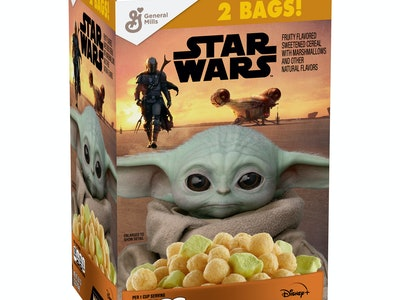 "A two pound box of cereal called ""The Mandalorian,"" with Baby Yoda on the front looking lovingly at the cereal."
