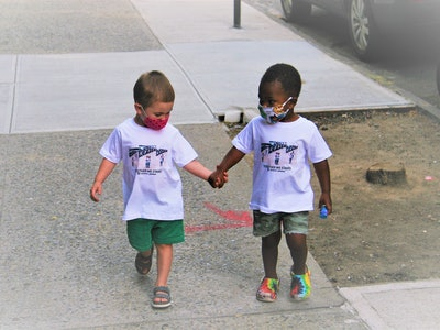 The two toddlers from the viral hugging video are now the stars of a viral fashion campaign with BOY MEETS GIRL, promoting racial equality.