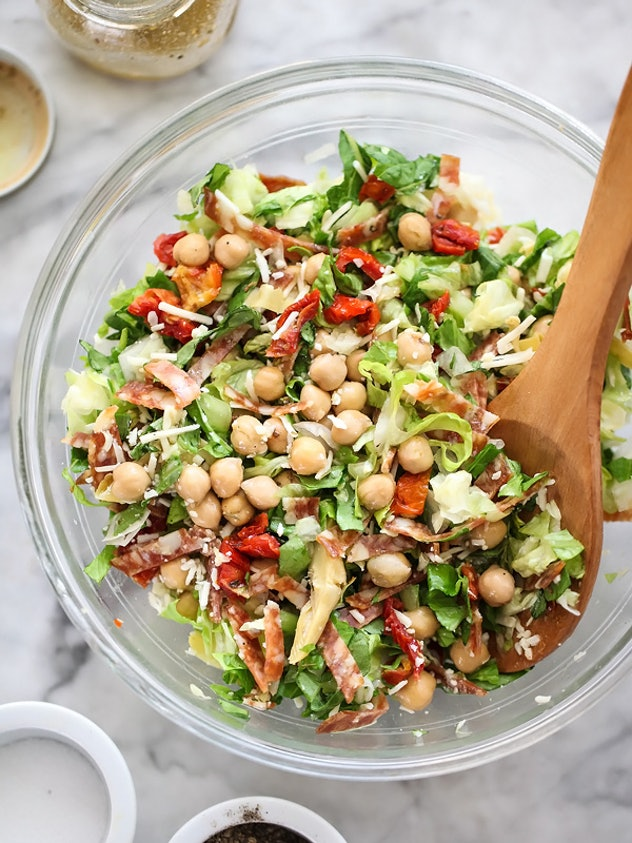 An Italian chopped salad with marinated chickpeas is the perfect summer dinner to have on the go.