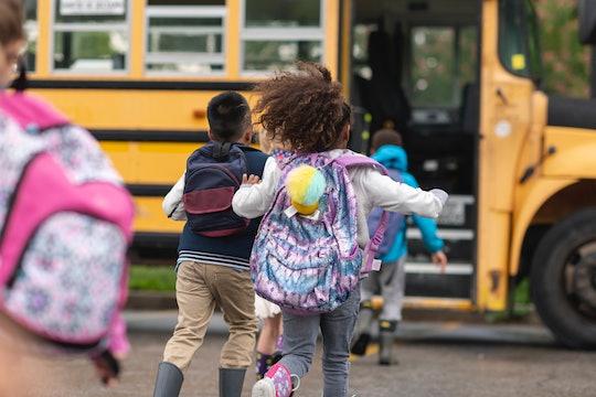 kids running for school bus