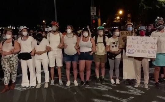 Moms formed a human shield to protect protesters in Portland, Oregon, from aggressive federal office...
