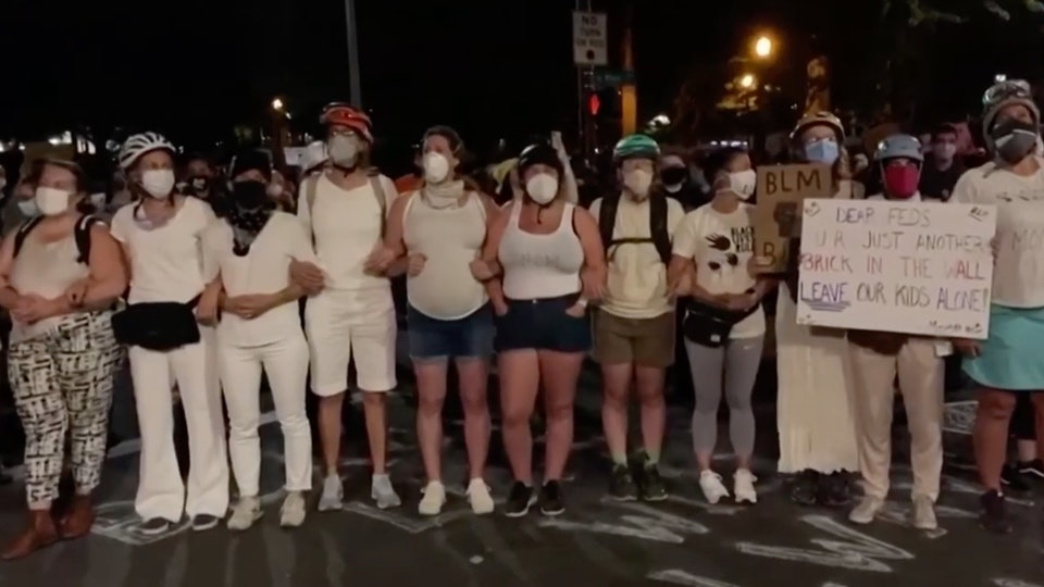 Moms formed a human shield to protect protesters in Portland, Oregon, from aggressive federal officers over the weekend.