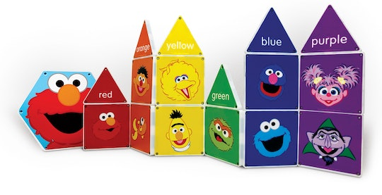A bunch of Magnatiles featuring Elmo, the Count, Bert, Oscar, Ernie, Abby, Grover, and Cookie Monster