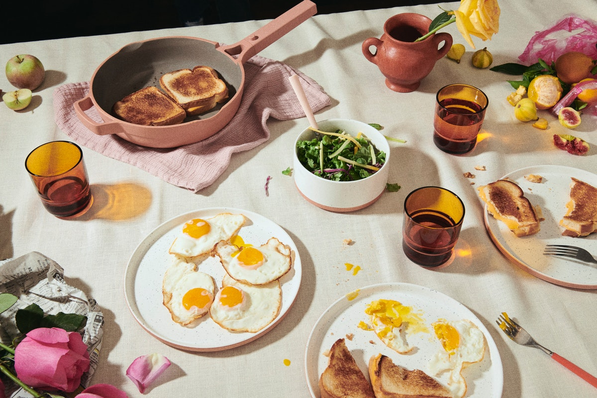 Fresh breakfast food is laid out on a table using cookware from Our Place.