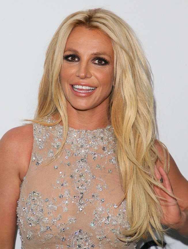 Britney Spears smiles in red carpet photo