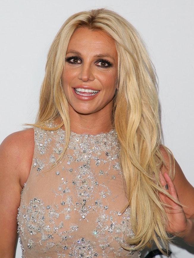 Britney Spears smiles in red carpet photo