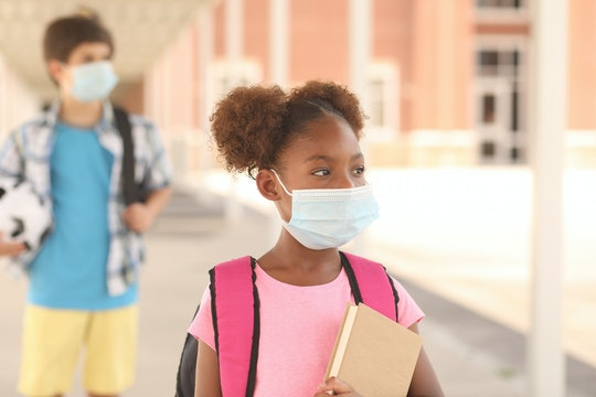kids walking into school with face masks