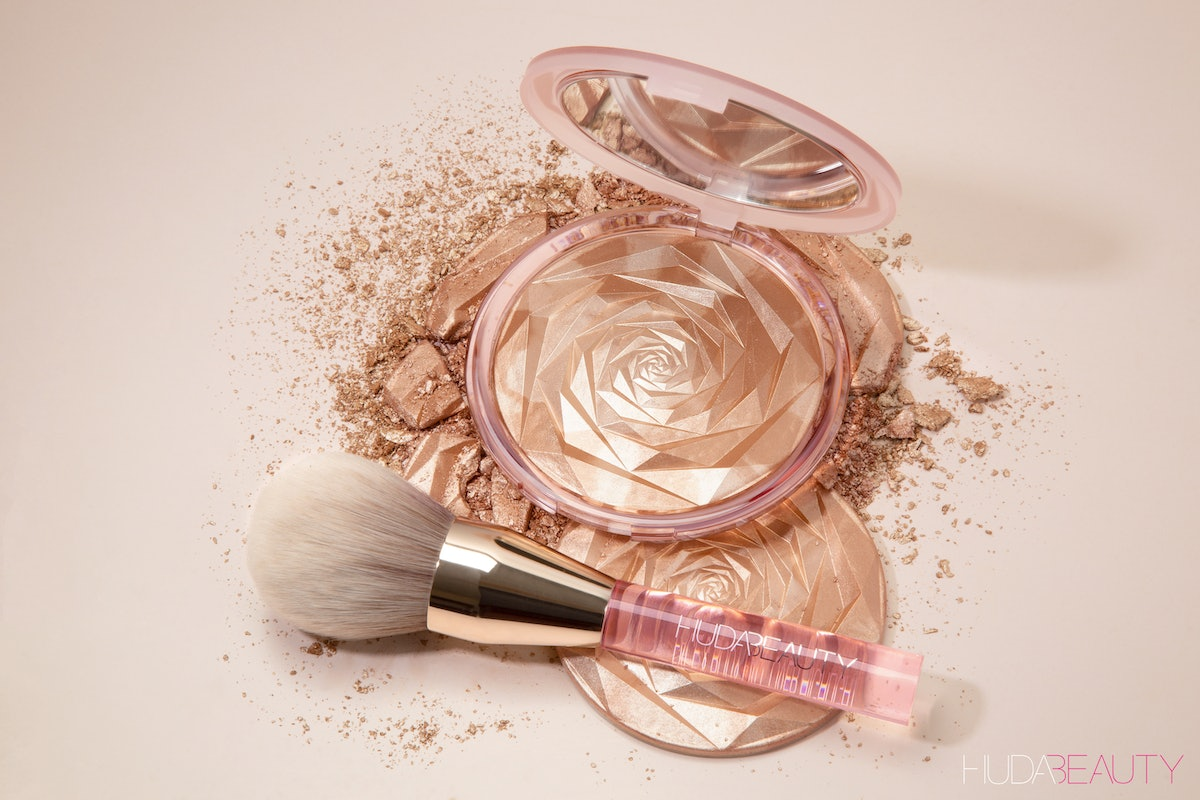 The new Huda Beauty highlighter is meant for your body and comes in a large compact.