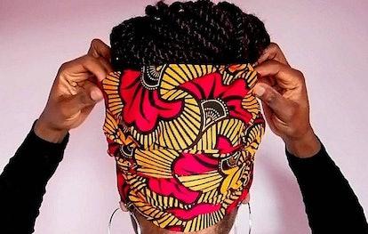 Model wearing brightly-patterned headwrap