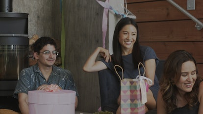 Josh Fadem, Constance Wu, and Jenée LaMarque sit around at a party in a still from The Feels