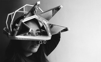 The Bloom headset distorts visual perception using a set of mirrors and a pair of lenses.