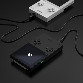 Two Pocket consoles connected via cable.