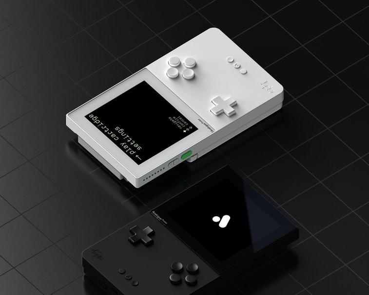 A black Pocket console and a white Pocket console sit side-by-side.