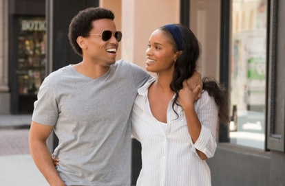 Michael Ealy and Joy Bryant walk arm in arm in a still from About Last Night