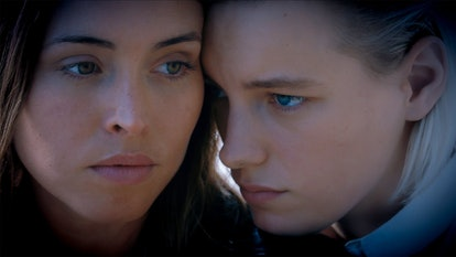 Erika Linder and Natalie Krill pose faces together in a still from Below Her Mouth