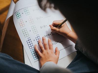 boy working on math assignment