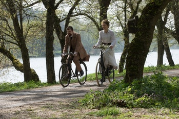 Pike, as Marie Curie, and Sam Riley (right) as physicist Pierre Curie, in 'Radioactive.'