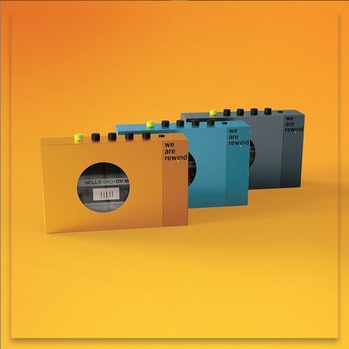 Three cassette players in orange, teal, and gray can be seen on an orange surface and background. The products are by We Are Rewind.