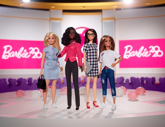 A blond Barbie, A Black woman presidential candidate Barbie, a brunette Barbie, and a honey haired Barbie, all ready to lead.