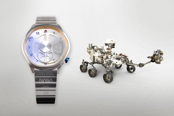 A watch next to the Mars Rover.