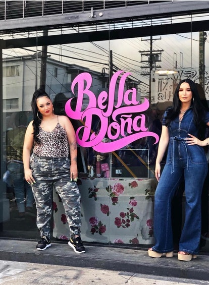 Natalia and Lala posing in front of their clothing line's storefront