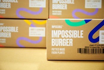 Boxes of Impossible Burger patties.