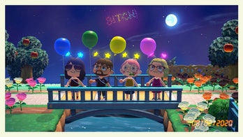Four players on a bridge in the game Animal Crossing: New Horizons