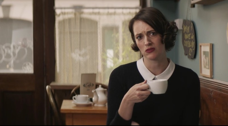 Fleabag holding a cup of coffee and talking about anal sex.