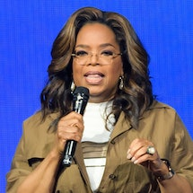 Oprah Winfrey speaking to audience from a stage