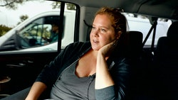A pregnant Amy Schumer rides in a car in her new documentary 'Expecting Amy'