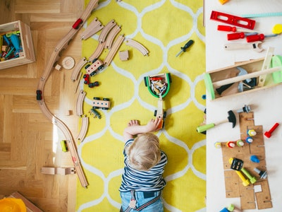 little boy playing with toys in playroom