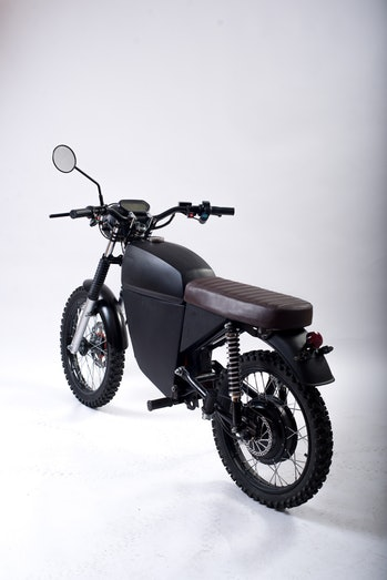 Studio shot of the BlackTea electric moped three-quarter view