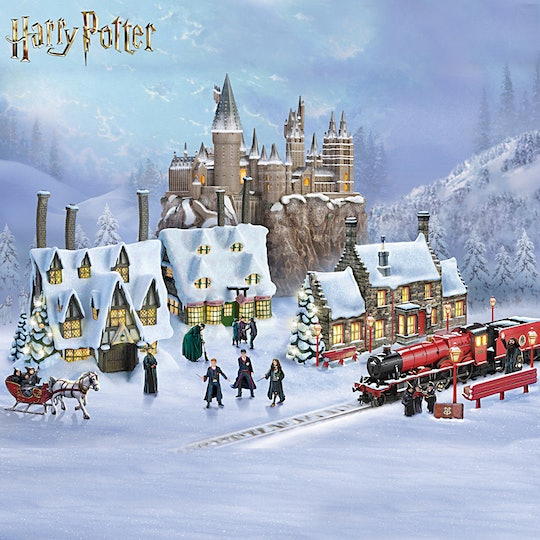 A depiction of an illuminated Hogwarts village complete with castle, characters, and Hogwart's Express.