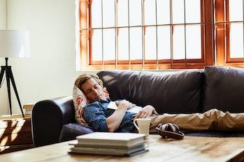Man sleeping on the sofa.
