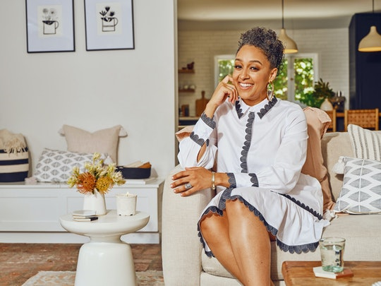 Tia Mowry x Etsy Collab. Tia sitting in chair
