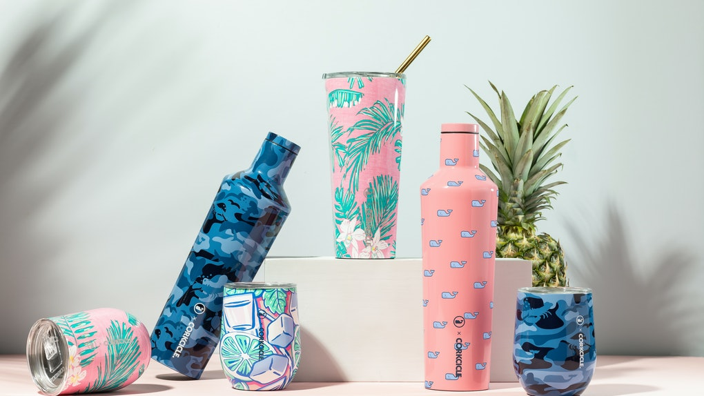 The Corkcicle x Vineyard Vines limited edition collection includes bright pink, blue, and teal colors and prints on classic tumblers and wine cups.