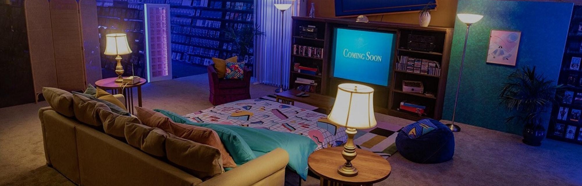 A '90s era living room built in a Blockbuster store.