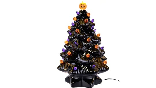 "Black ceramic ""Halloween"" tree with orange and purple light bulbs and a lit up pumpkin on top"